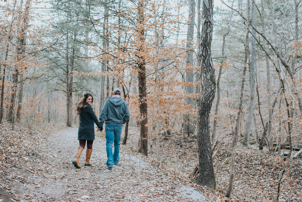 Couple walking in a wooded trail