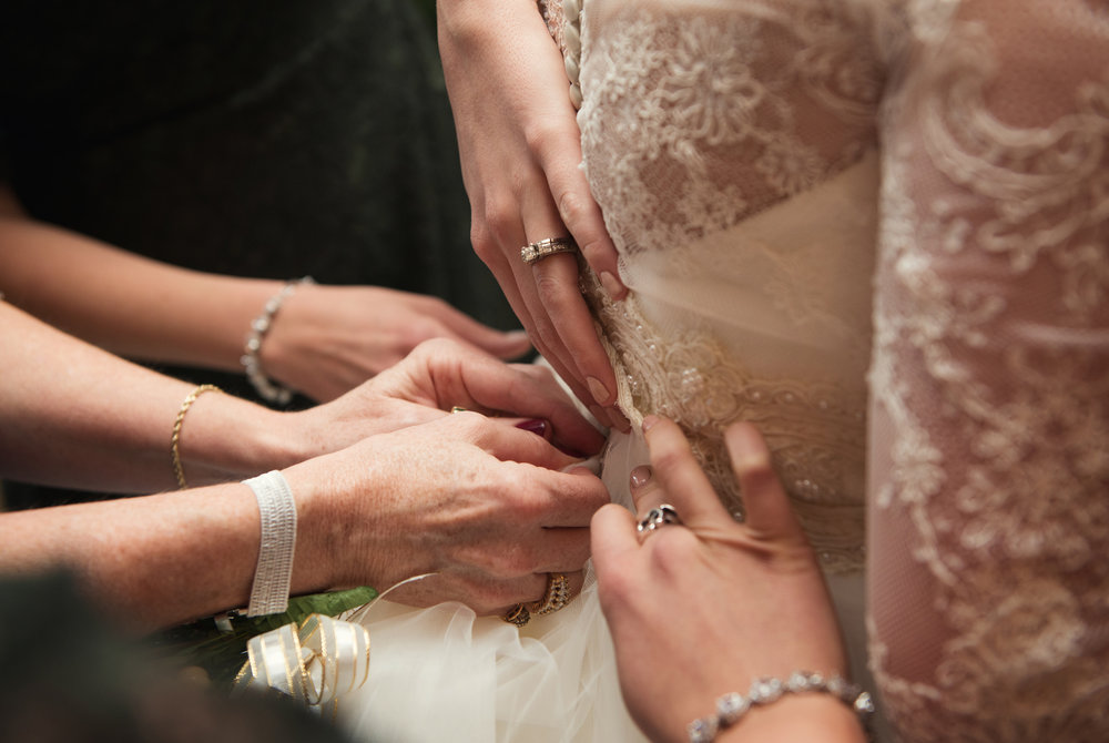 fastening the bride's dress