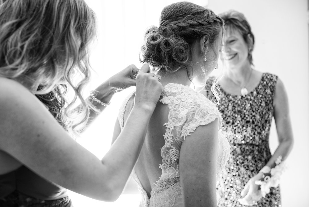 Bride getting ready, back lit