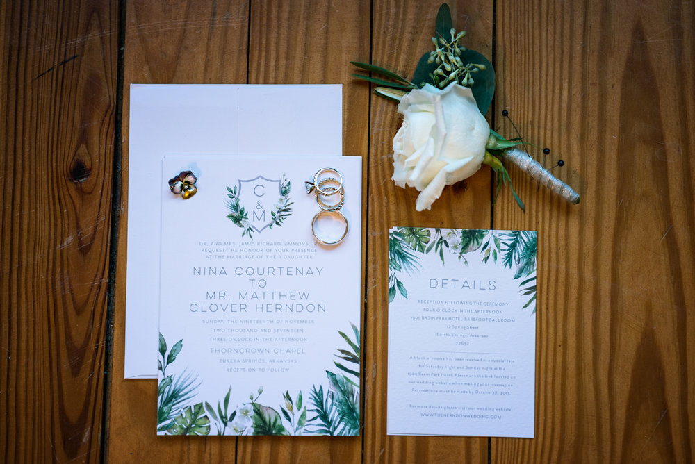 Wedding invitation suite with wedding rings and boutonniere