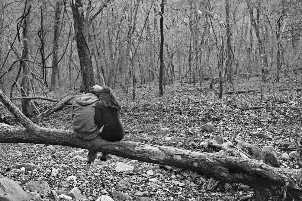 Engagement couple alone in woods