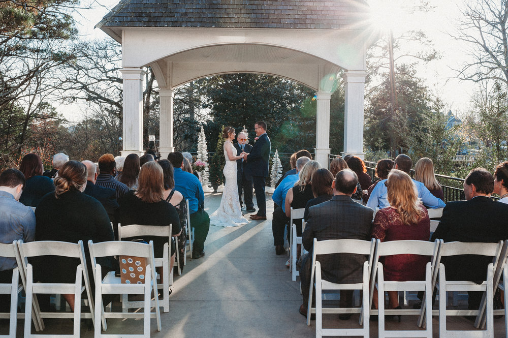 Wedding ceremony under Crescent Hotel Conservatory Gazebo