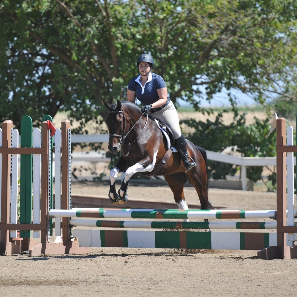 "Janelle's drive and dedication to our sport is uplifting to everyone around her.  She is not only a great rider but a wonderful horsewoman, spending as much time as she can caring for her horse ""Sophia.""  Janelle and Sophia began their jumping career when joining Pyramid in 2015, and compete in the Hunter and Equitation rings. With much success in just the last year, we see many victories in their future in the Jumper ring also.  Janelle makes everyones life run smoother at Pyramid through scheduling and organization."