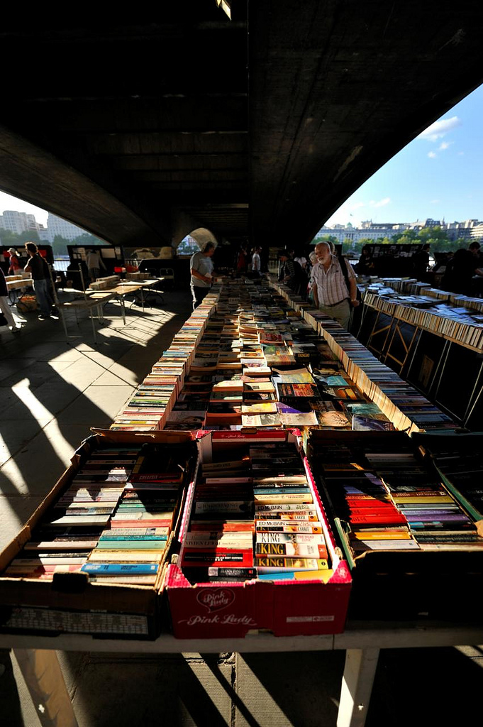 teachingliteracy :     South Bank Book Market (by  MrHRdg )      Ooh. Someone snag the Stephen King books in the Pink Lady box for me… I collect different editions.  A.M.