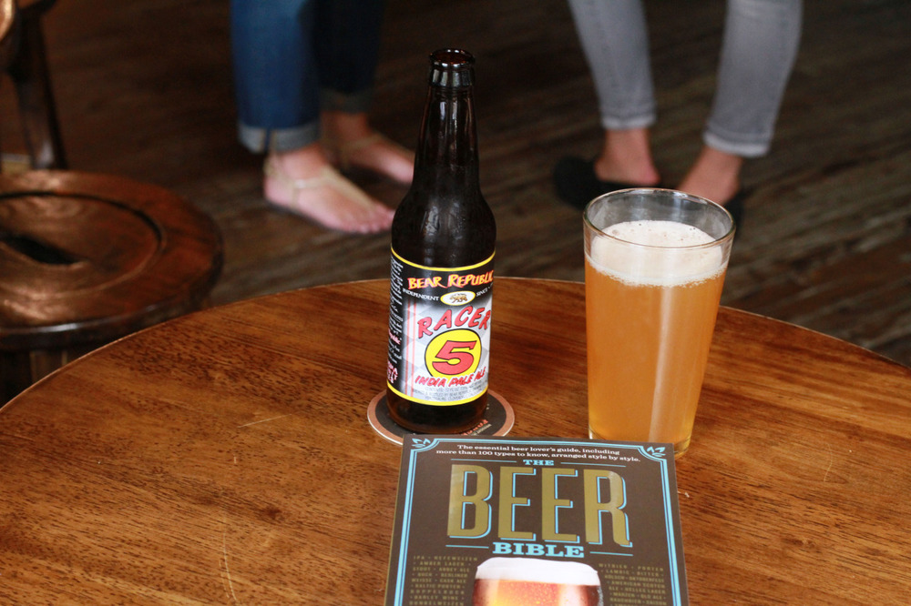 "workmanpublishing: Happy pub day to The Beer Bible! What pairs best with this book? Well, beer, of course. Author Jeff Alworth recommends Bear Republic's Racer 5, calling it ""a dangerously approachable, layered & classically funky California ale."" Is it 5 o'clock yet? If it's not 5 o'clock where you're at, you can borrow Pittsburgh's time zone for a bit. It's well after 5 here. Beer time. A.M."