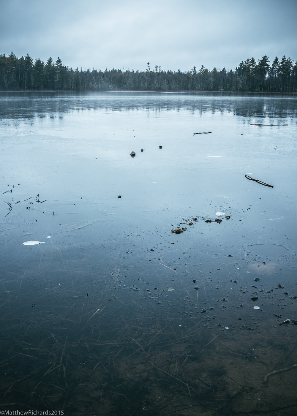 Pond in Sebago, Maine beginning to freeze