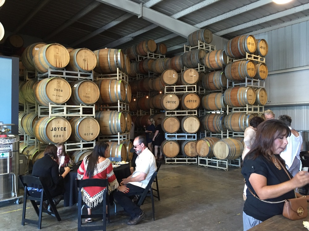 Looking towards the estate wines tasting corner among the barrels