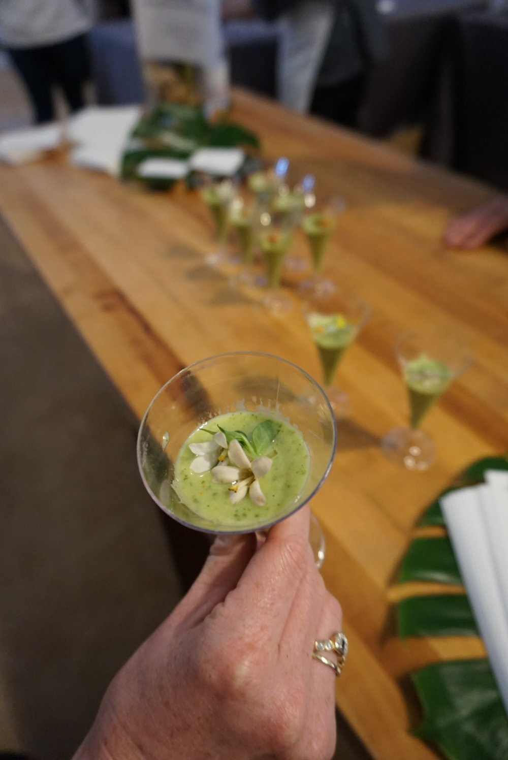 Avacado, mint and cucumber shooter topped with créme fraîche and wild flowers