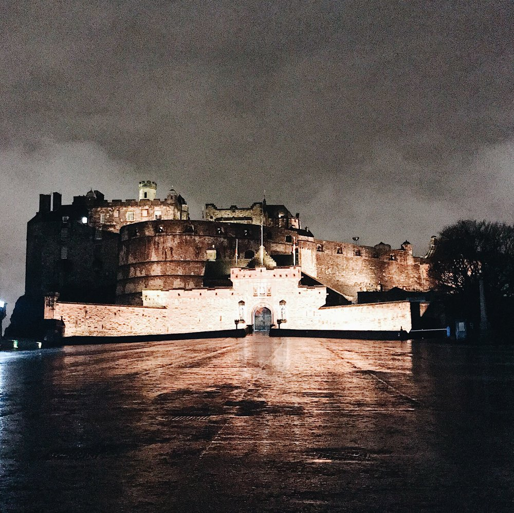 View of castle lit up at night