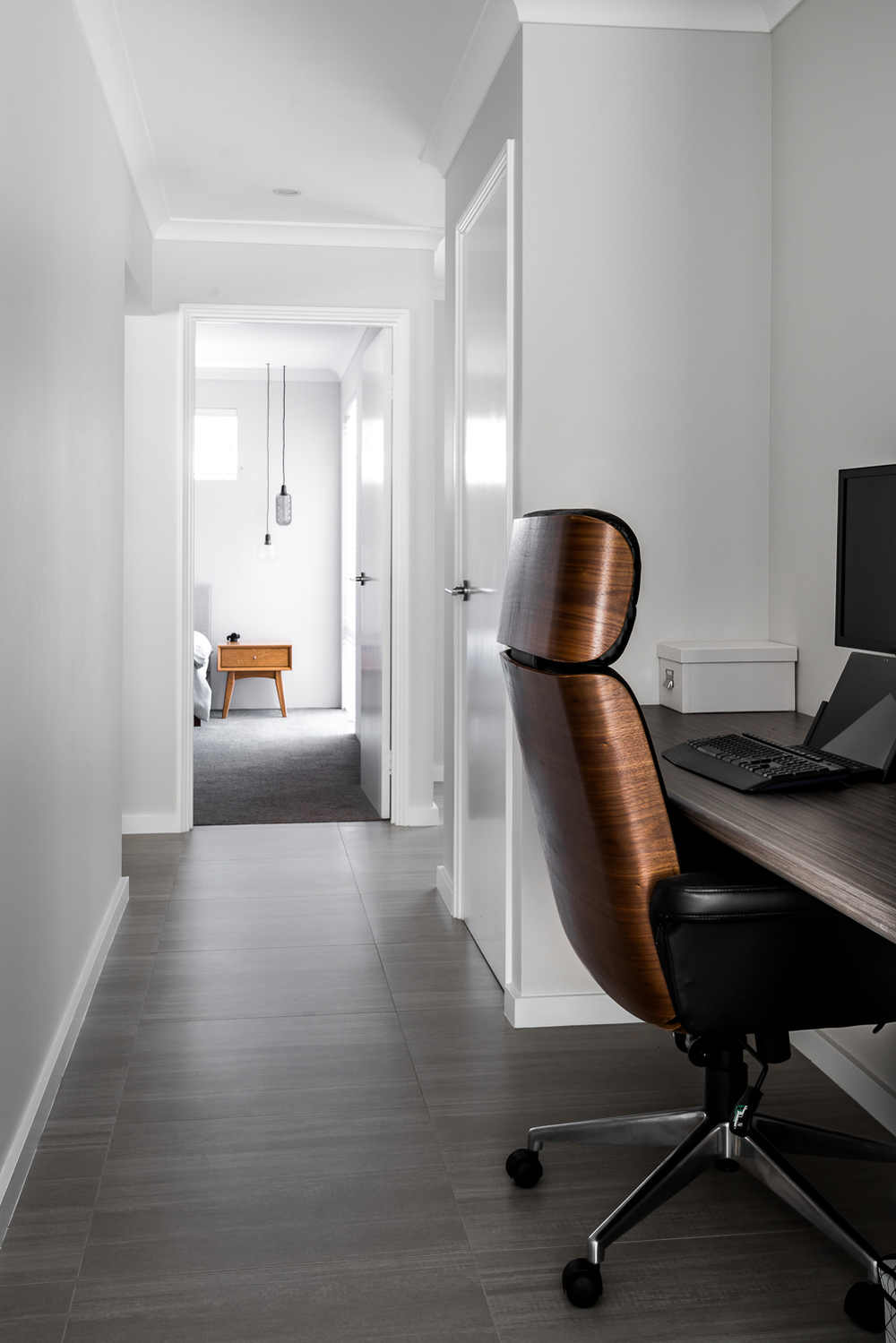 Study nook within second wing passageway design by DALECKI DESIGN