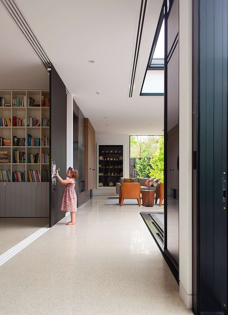 Additional living space, which can be hidden behind sliding doors designed by EAT ARCHITECTS