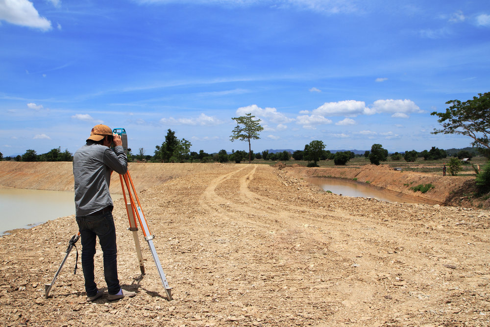 Surveyor conducting a feature and contour survey.