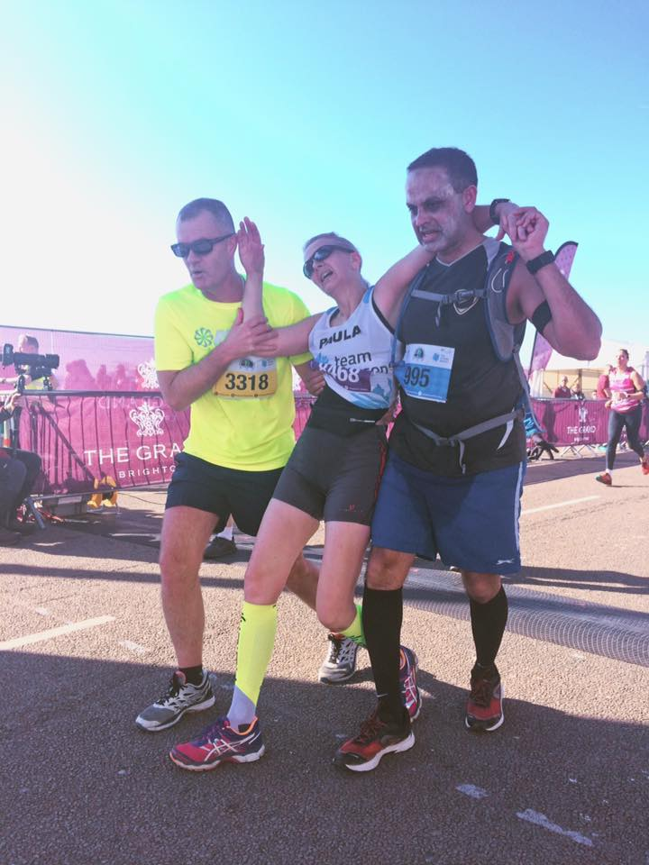 Over the finish line! Paula Elphick (centre) from Team Beacon with Richard Cruse (left). Runner (right) name unknown