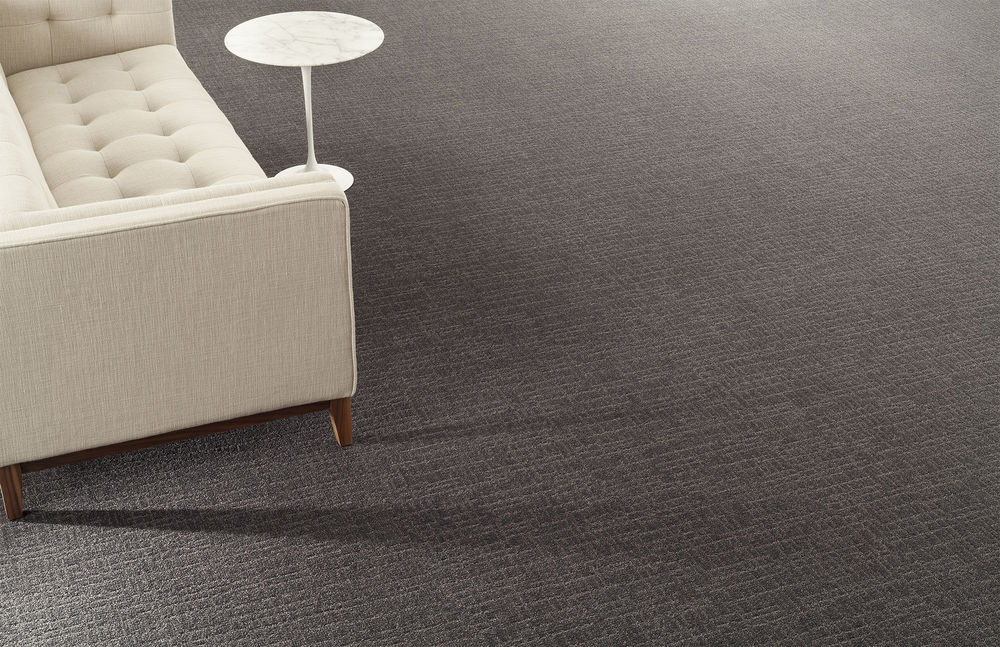 Tufted Milliken Carpet Design With Beige Sofa Design