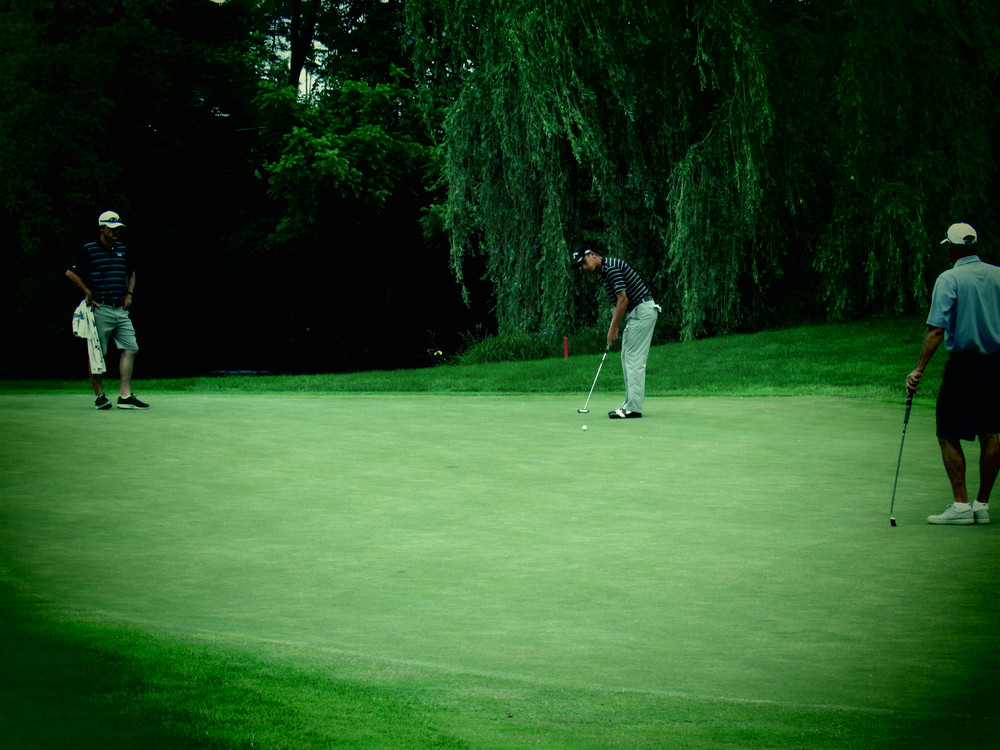 Vince India rolling a birdie putt on the 2nd green during Monday's Celebrity Pro-Am