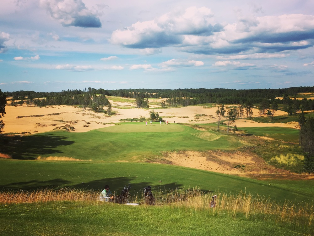 The short iron shot into the 5th green at Sand Valley.