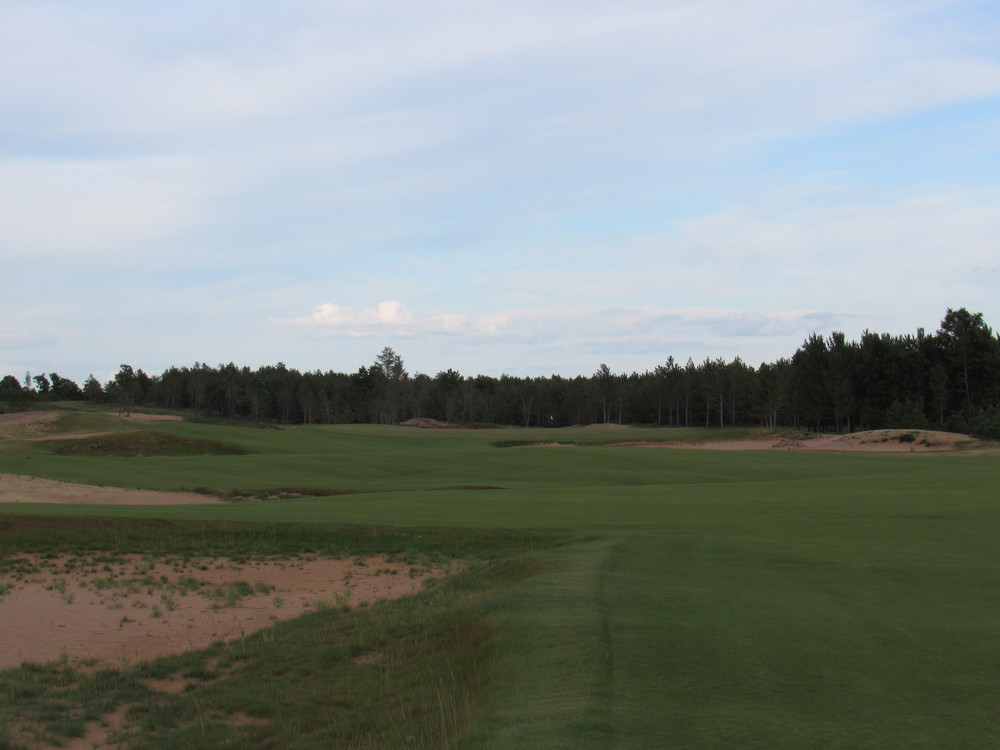 The approach to the 6th green at Sand Valley.