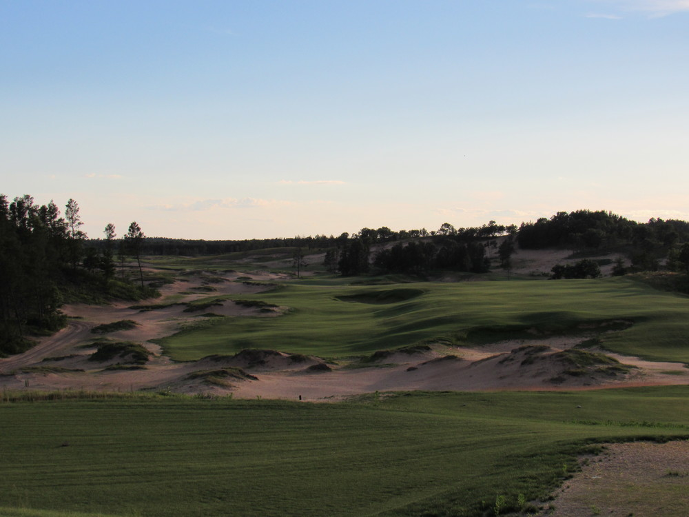 The 10th tee shot at Sand Valley requires players to avoid the giant bunker in the middle of the fairway.