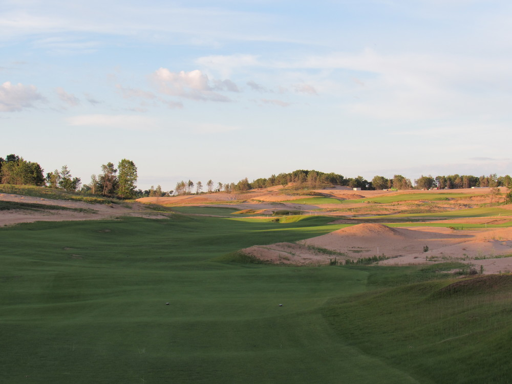 The par 4 dogleg left 16th at Sand Valley.