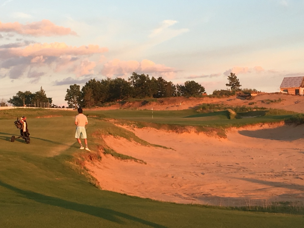A look at the deep bunker guarding the 18th green at Sand Valley.