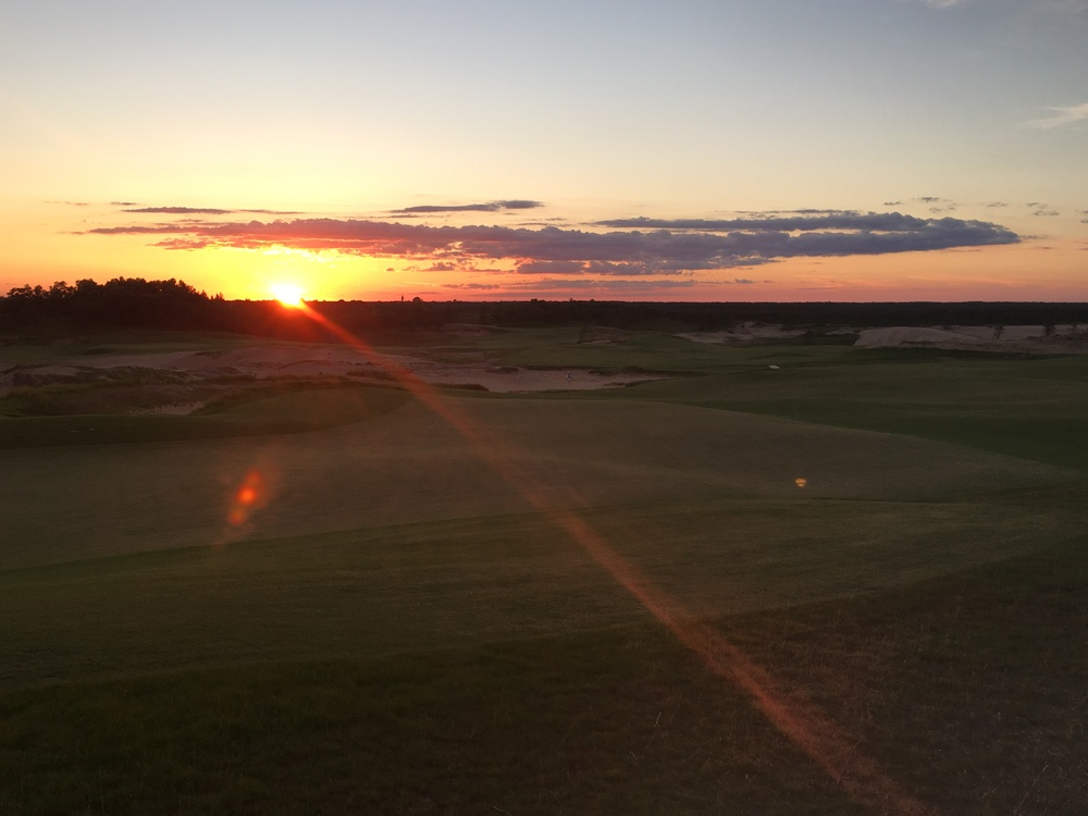 The sun sets on an epic day at Sand Valley.