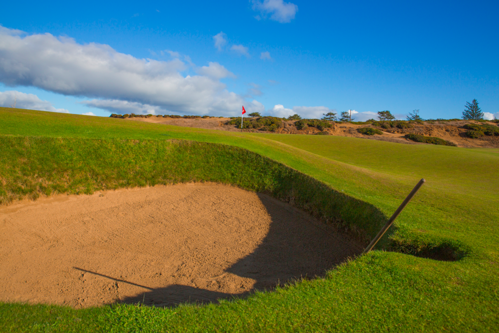 The approach to the 11th is very difficult with the pot bunker that guards the left side of Old Macdonald's green. Photo Credit: Bandon Dunes Golf Resort & Timothy Scahill