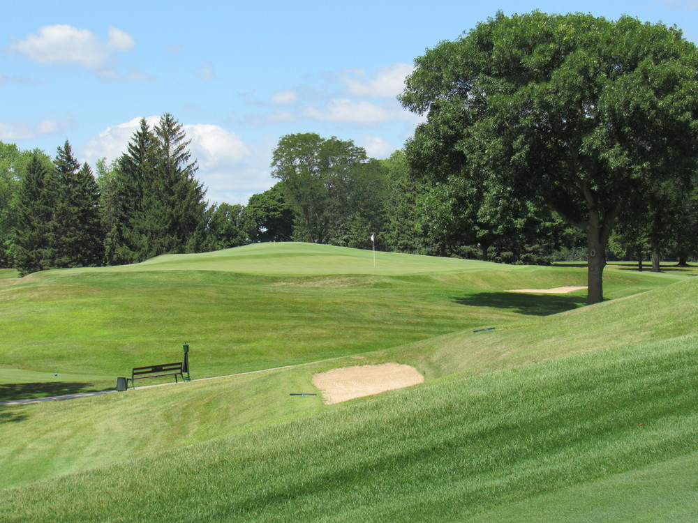 A look at the 13th green from the 12th fairway shows the great slope.