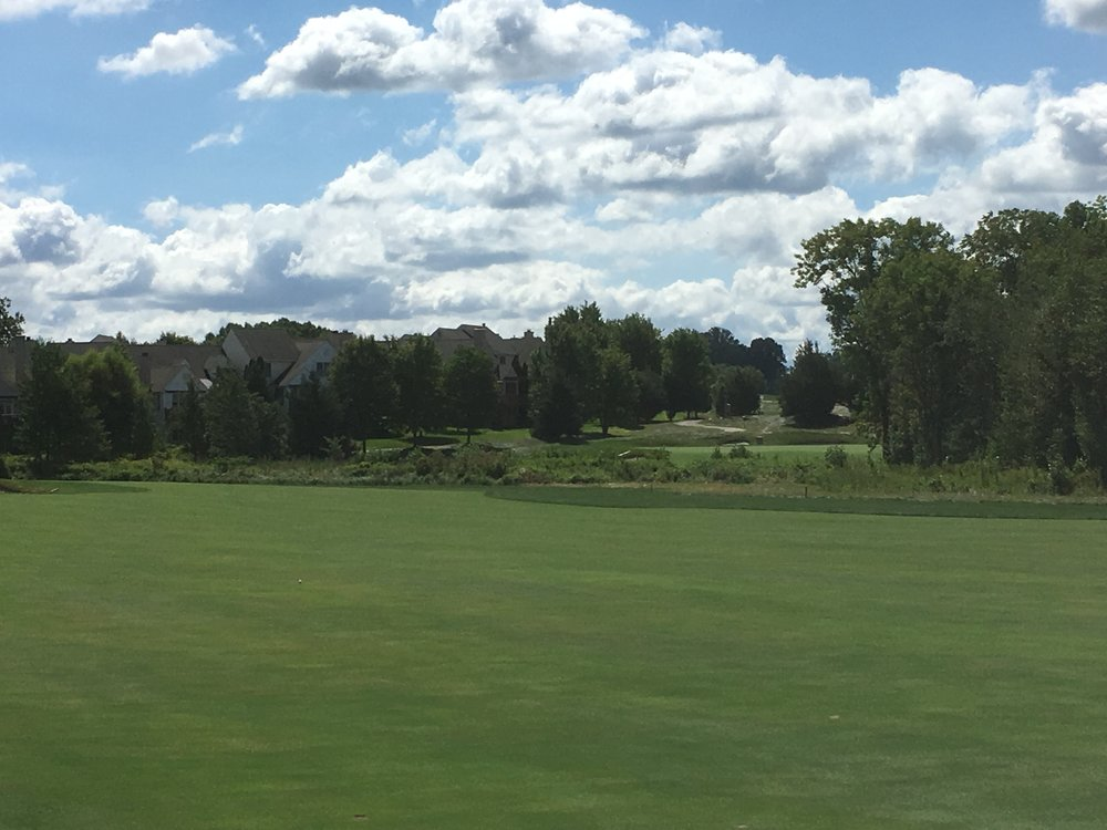 The view of the green from the fairway at the 16th.