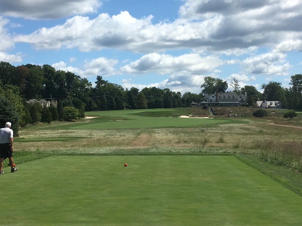 The 18th tee shot with the clubhouse in the background.