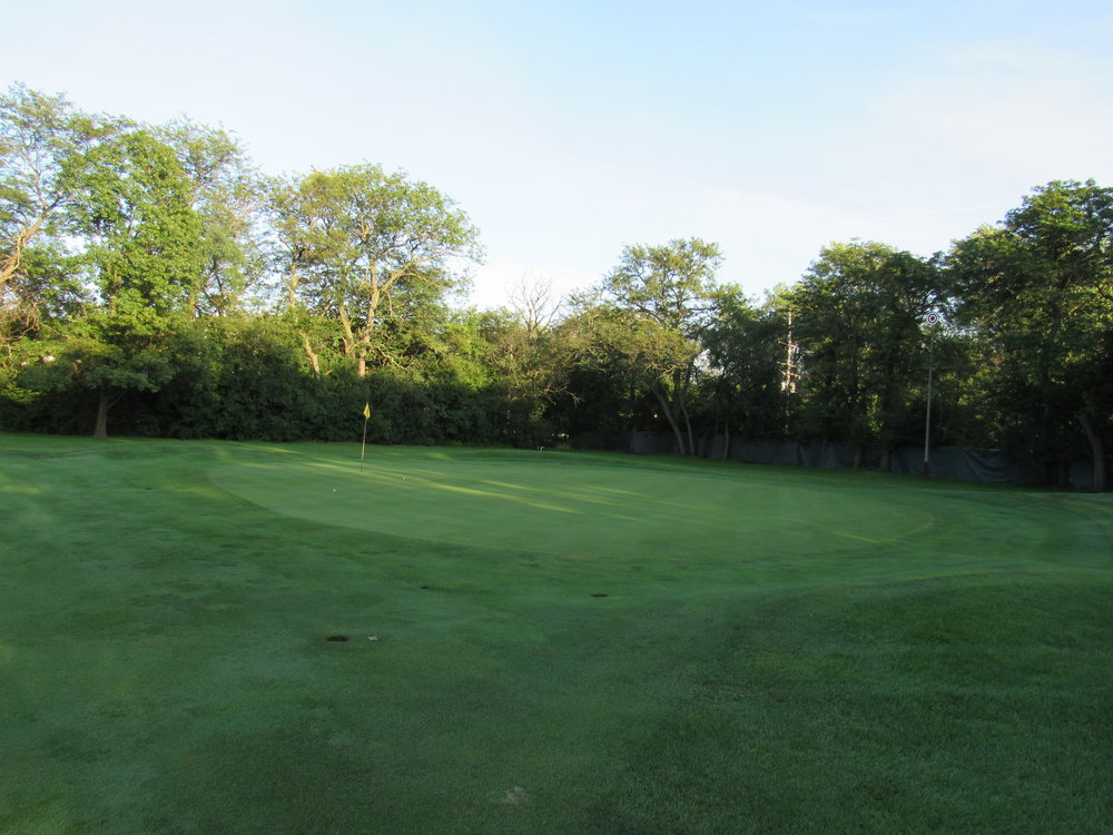 The green at Flossmoor's 12 slopes away but is built up into a subtle punchbowl.