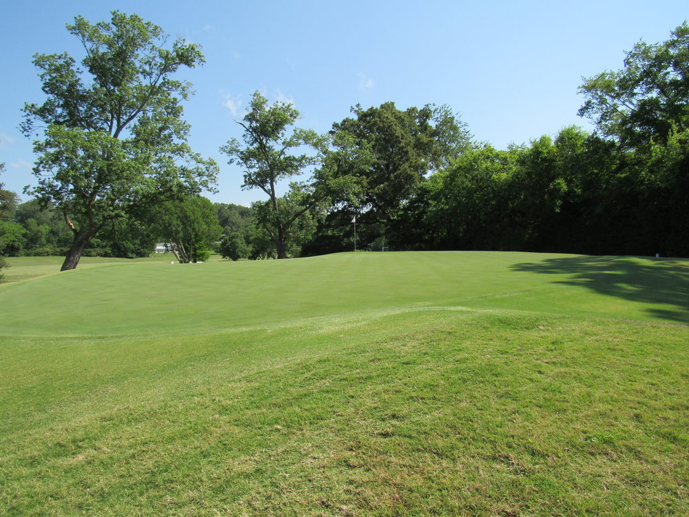 The small and hard sloping 16th green at Holston Hills.