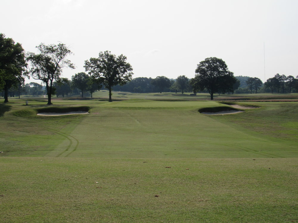 The approach left from a tee shot that successfully challenges the right side.