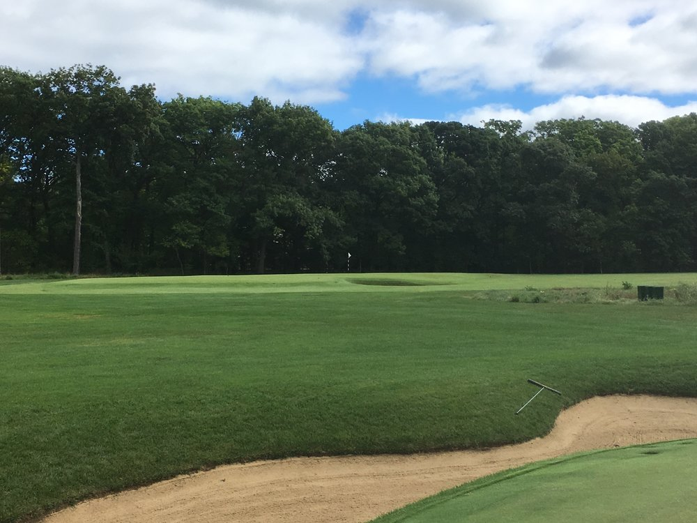 A look at the 10th green and the road bunker from the 8th green.