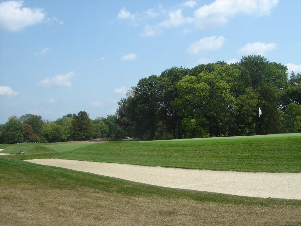 The side of the 8th green shows how deep the bunkers are.