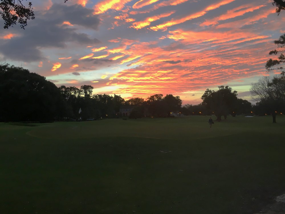 The sun setting on a fine 9 holes at Winter Park GC.