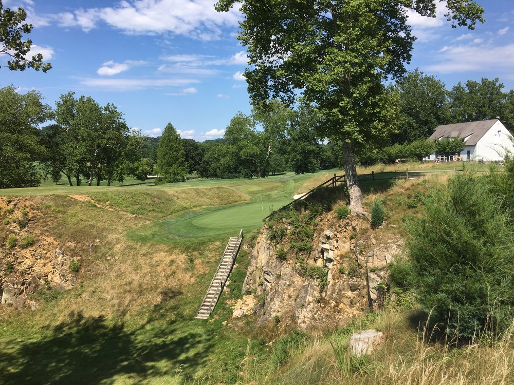 The par 3 8th plays into a quarry at Manufacturers