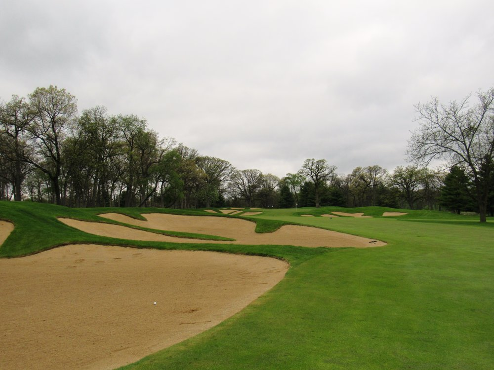 The bunkers which guard the tee shot from the left fairway