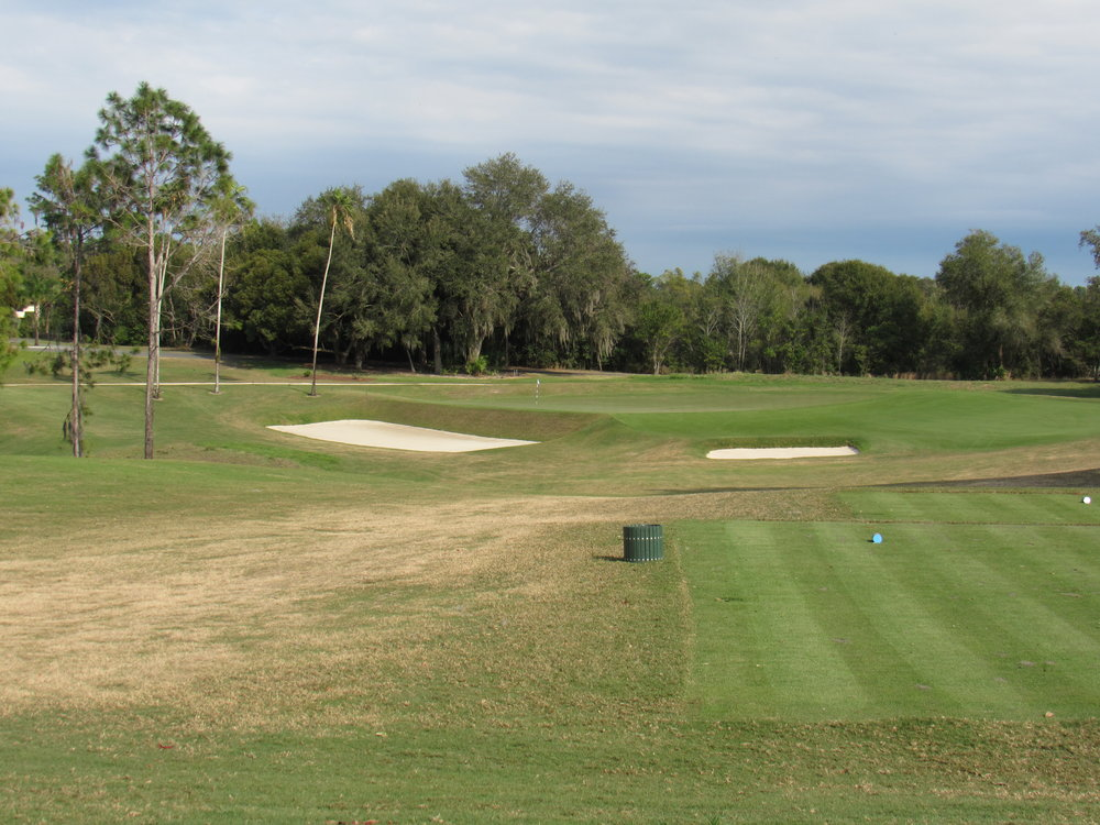 The tee shot to the 8th at Mountain Lake must avoid the big front bunker