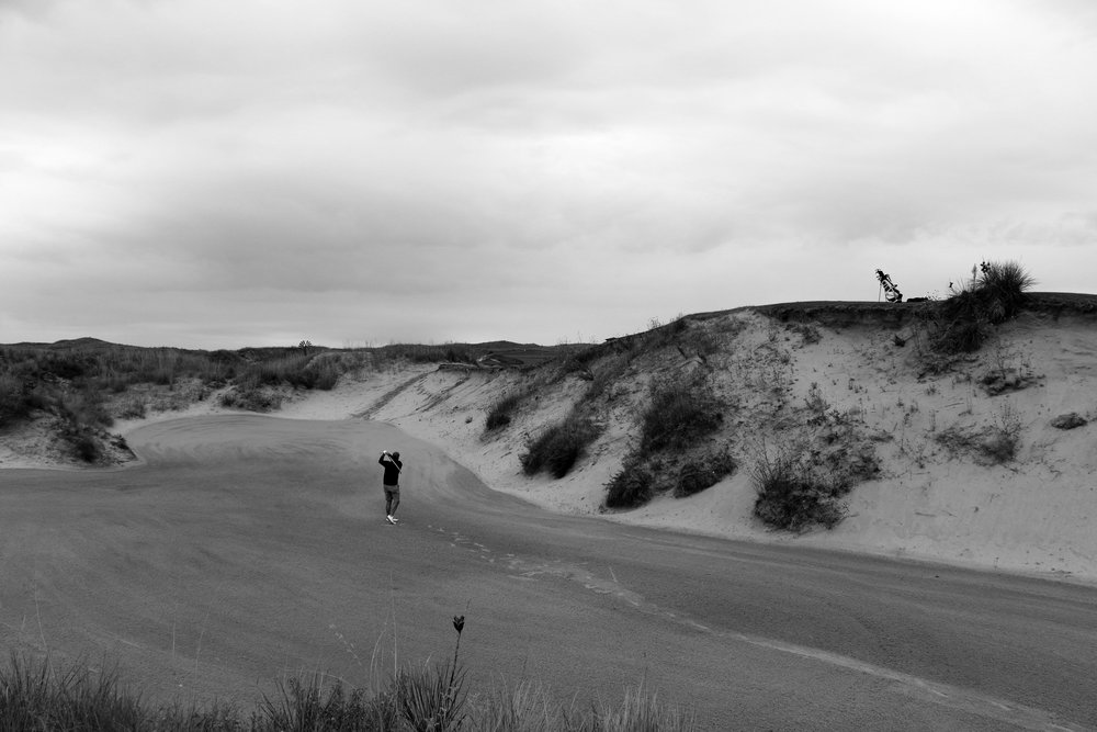 The deep fairway bunker which guards the left side of the 18th fairway at Sand Hills Golf Club.