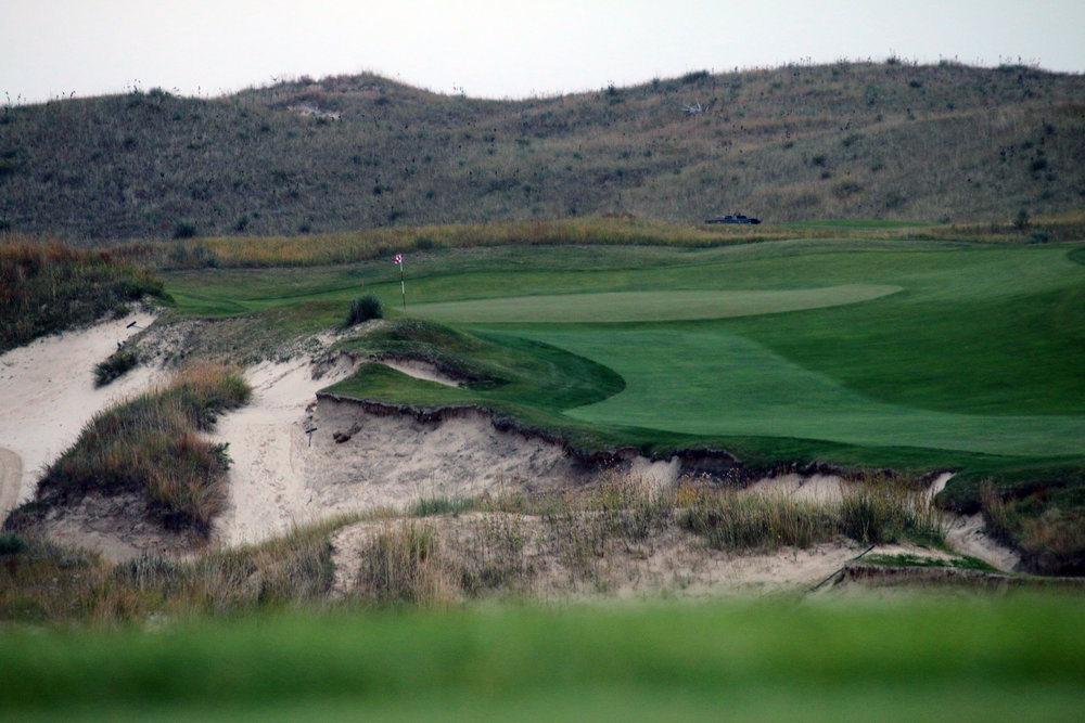 The rugged and nearly 30' deep greenside bunker at the 18th.