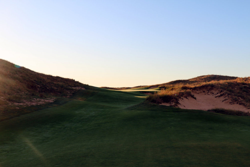The massive sand dunes and bunkers that the 16th green of Ballyneal sits between