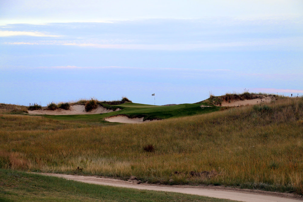 A perfect shot is required to hit the 150 yard 17th green, especially when the wind blows.