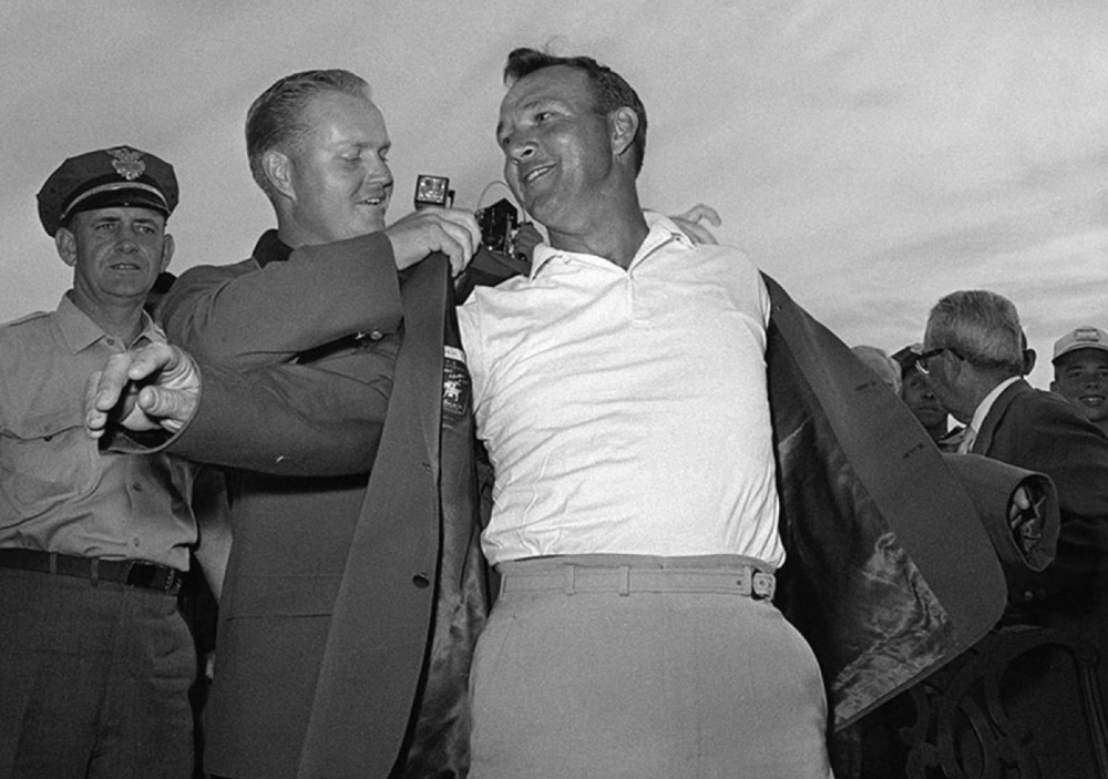 Arnold Palmer putting on the Green Jacket Photo Credit: Arnoldpalmer.com