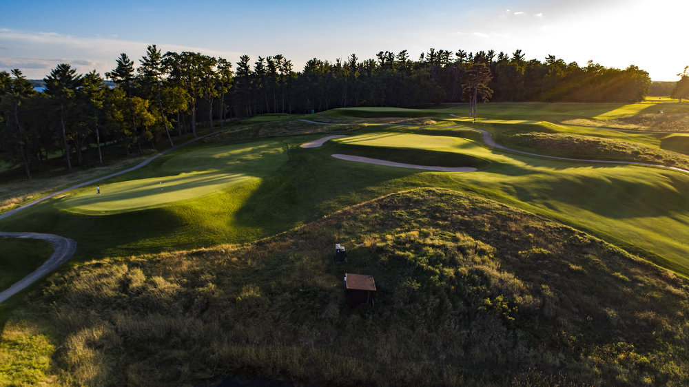 The ridge where the 14th (left), 13th (center) and 10th (right) greens rest.