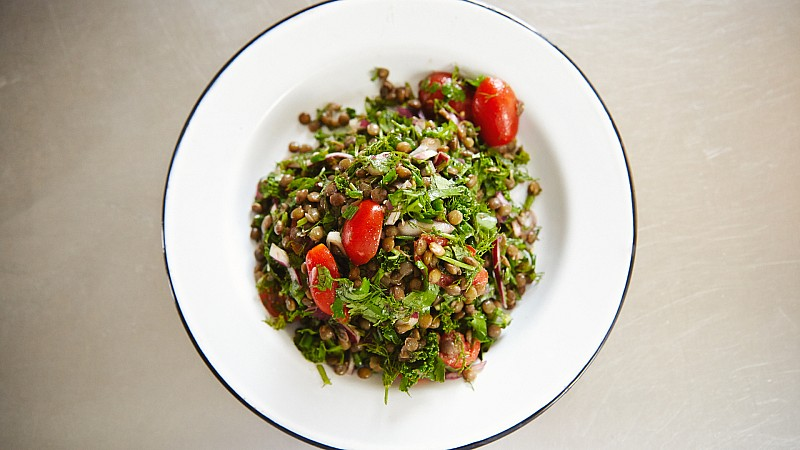 Catherine-Cuello-drains-lentils-for-her-French-Lentils-and-a-Ton-of-Herbs-recipe-Foodadit.jpg