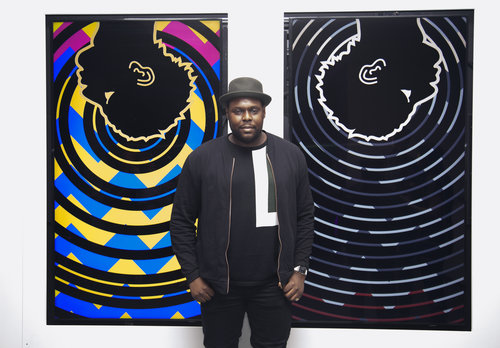 Damien Davis, (spring '16 fellow),  in front of two of his artworks at MoMA, NYC, Feb. 2017.