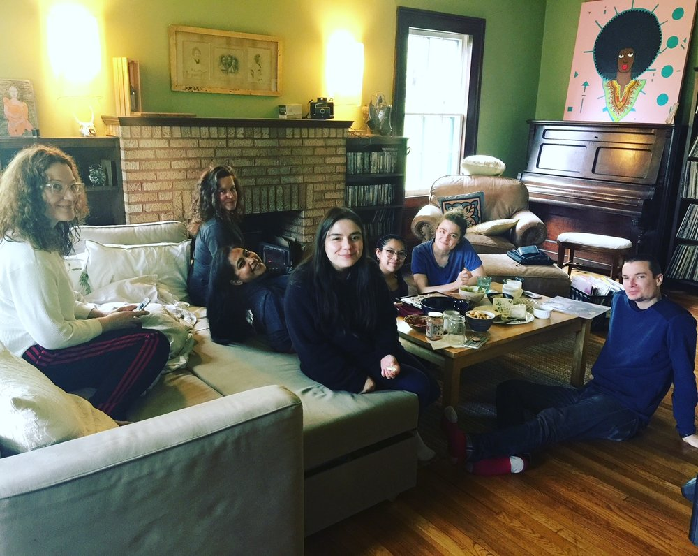 Spring 2018 fellows hanging out around fireplace and watching movies at our traditional retreat at Denniston Hill (May 2018).