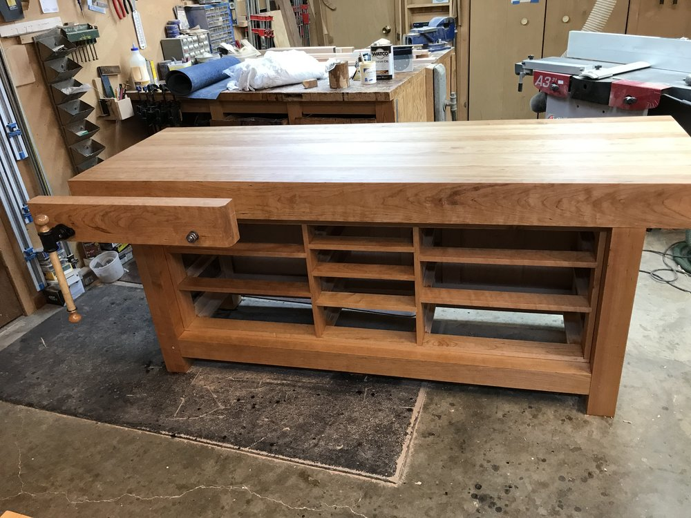 Photo of bench without drawers and with vise extended.