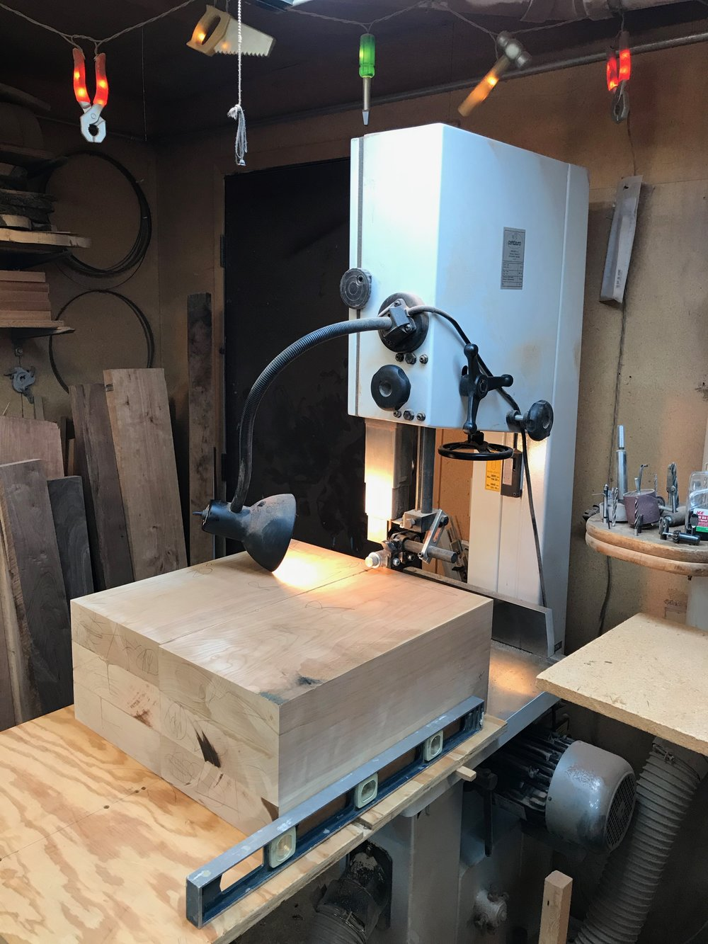 At the bandsaw, being readied for the circle cut.