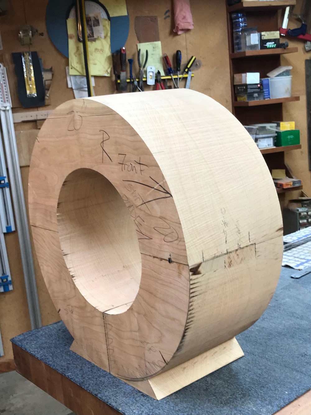 After opening a kerf line at the base to the center, I circle cut the center and removed it.
